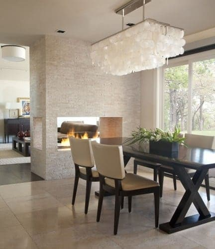 Contemporary dining room with modern fireplace