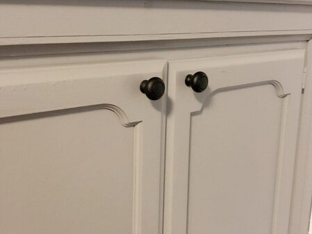 wet bar cabinets with black knobs