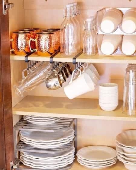 Organize glassware: stack plastic cups sideways in a bottle holder