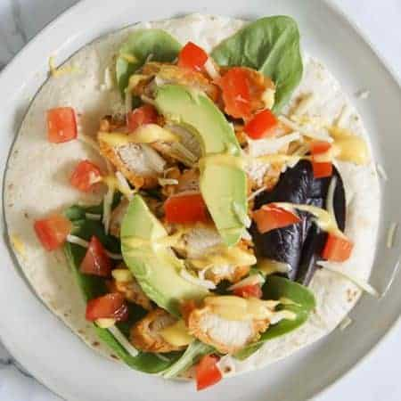 Crispy Chicken Wrap - tortilla with lettuce and chicken and cheese and avocado and tomato and honey mustard dipping sauce
