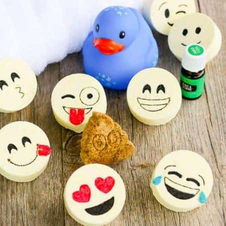 The final product of this bath bombs recipe are these adorable kids bath bombs with emoji faces. A fun show showing the completed bath bombs and other bath essentials.