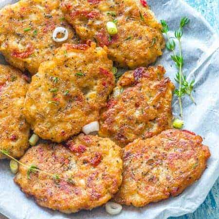 Saltfish fritters with thyme on a plate