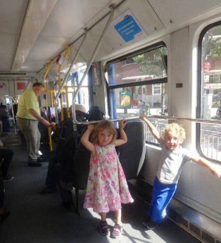 Two kids on the gvb tram in amsterdam