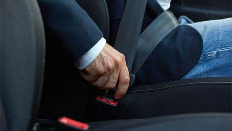 Driver fastens his seatbelt