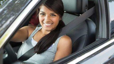 Female teen driver in car