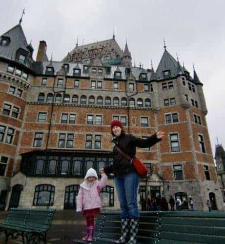 Mother and daughter in front of castle-like chateau frontenac