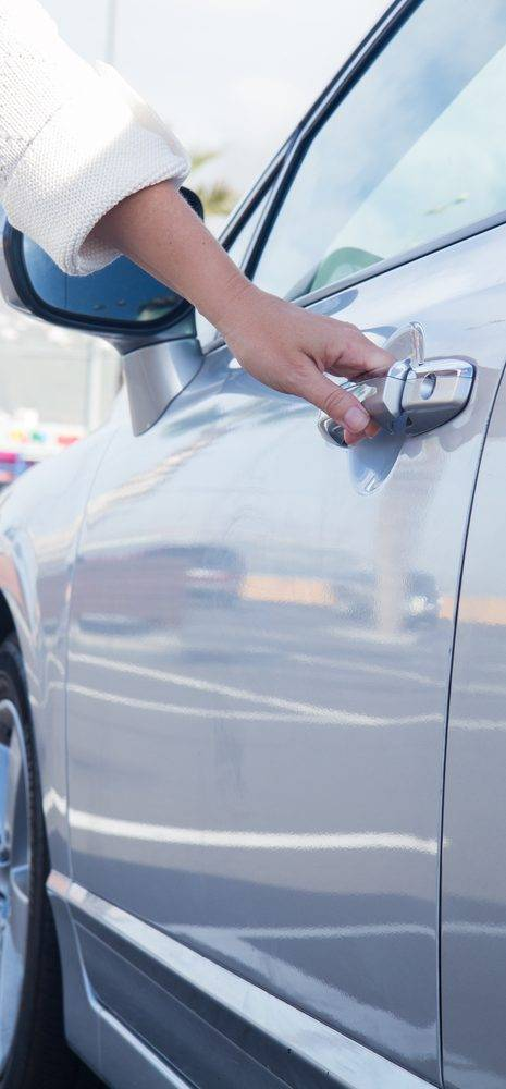 hand opening a car door