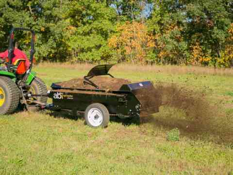 Tractor 50 PTO manure spreader shredding manure