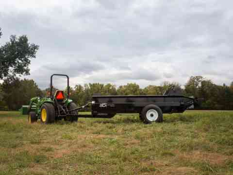 125 PTO pull behind Manure Spreader in a pasture