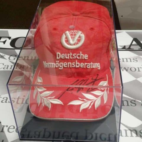 NOW SOLD - Schumacher signed Ferrari cap in perspex case.
