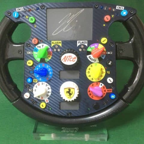 Kimi Raikonnen signed World Champion_ F 2007 Ferrari steering wheel_F1. Not Amalgam.