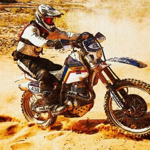 "White ""438"" motorcross running on desert"