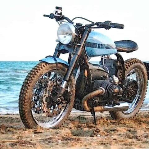 Lt. blue BMW bike on the beach