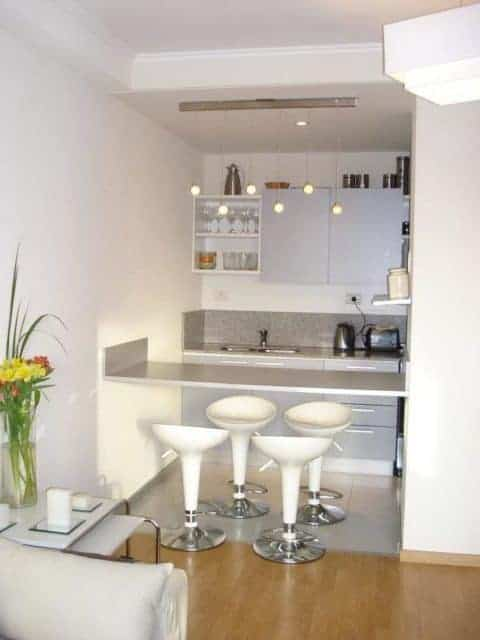 White kitchen with a mini bar