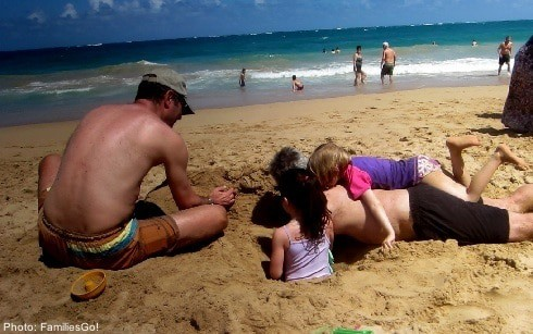playing in the sand on the Condado in Puerto Rico