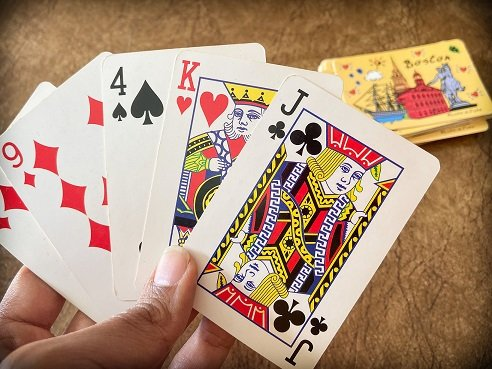 Travel card games with a deck of cards
