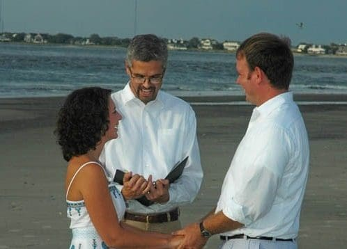 Officiant marrying a couple on the beach. Wedding dinner cruise Charleston SC