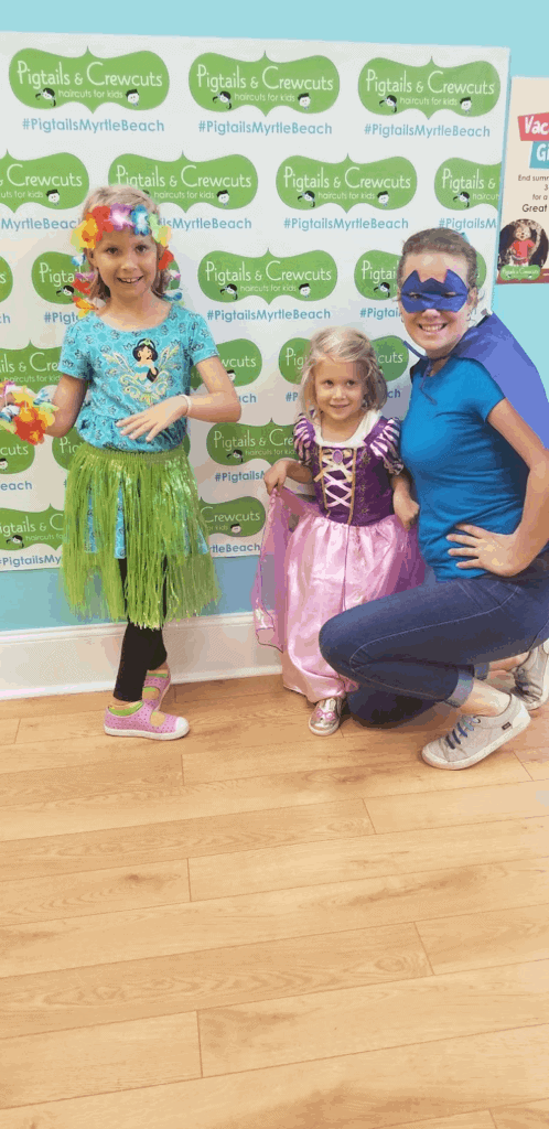 Bobbei Ruswinckel, children's hair salon franchise owner, with two little girls