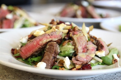 Beef Tenderloin Salad Recipe! With a mix of cranberries and pears, topped with honey mustard dressing, this sweet and tangy salad is addicting.