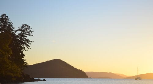 sunset view over Whitsunday islands from Cid Harbour