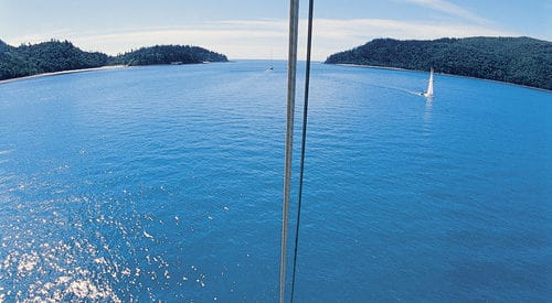 Image of a yacht motoring through Hook Passage taken from the top of the mast