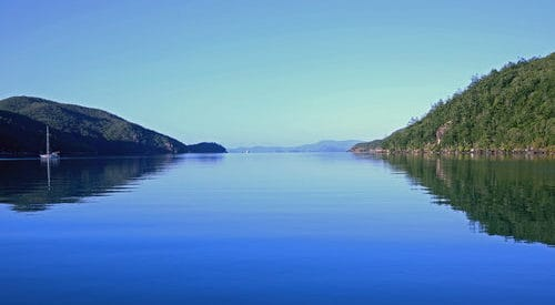 Nara Inlet still calm waters on Hook Island in the Whitsundays