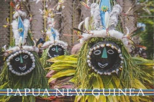 Postcard from Papua New Guinea showing traditional dolls or puppets