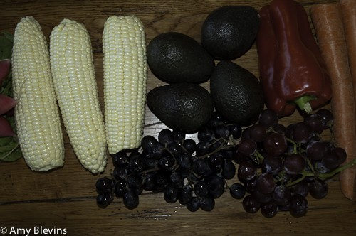 Vegetables - corn, red pepper and fruits grapes avocados