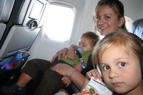 toddler sleep on plane, toddler sleep on a plane, Child Free Flights, Traveling Parents, Traveling Children, family on plane
