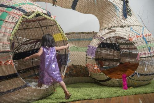 Kids don't look at art at cmom, they crawl inside, climb and more.