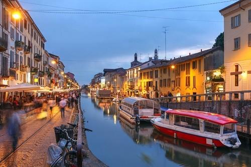 Enjoying a relaxing evening along the Naviglio Grande canal in Milan, Italy.