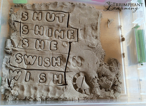 """Use kinetic sand and play-dough stampers to build word families. Suggest a word such as """"cat"""" and have your child stamp other letters to replace the first letter to make a new word."""