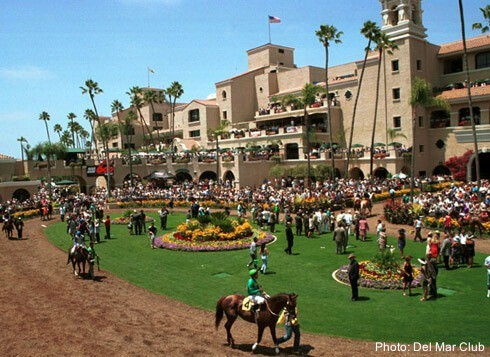 Beautiful and historic del mar racetrack in southern california, has lawns and art deco buildings.