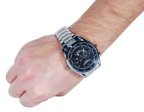 hd watch with hidden camera and silver band on wrist