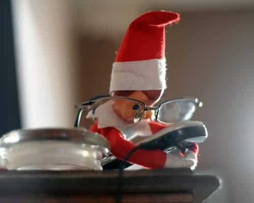 25 of the BEST Elf On The Shelf Ideas! Find fun posing ideas for moving your elf, cute free printables, arrival ideas. Naughty elf is texting in the middle of the night.