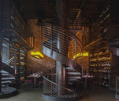 The stunning spiral staircase and wine wall within Purple Café and Wine Bar in Bellevue. Image courtesy Visit Bellevue.