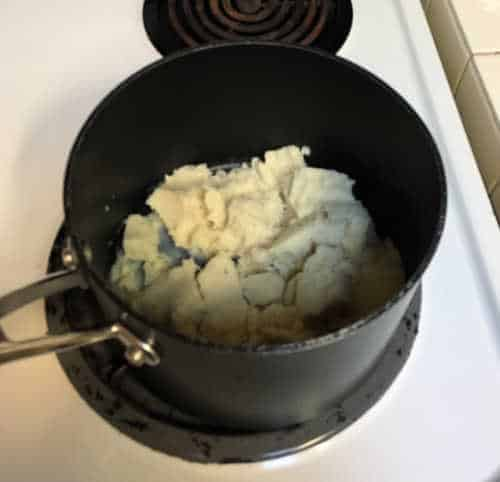 adding in the ingredients on stove top