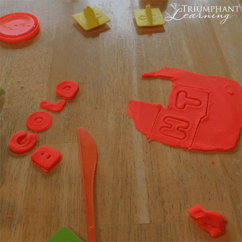 """Use play-dough and play-dough stampers to build word families. Suggest a word such as """"gold"""" and have your child stamp other letters to replace the first letter to make a new word."""