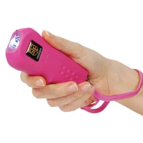 pink trigger stun gun woman's hand