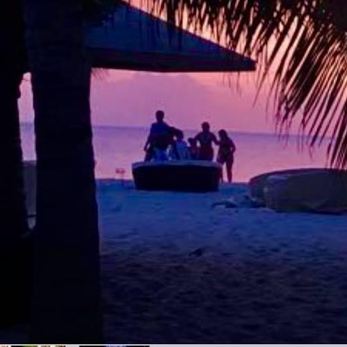 A family enjoys a sunset at jacqui o's on antigua