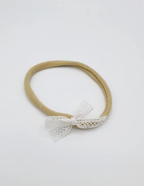 Taupe nylon haarbandje met kanten strikje