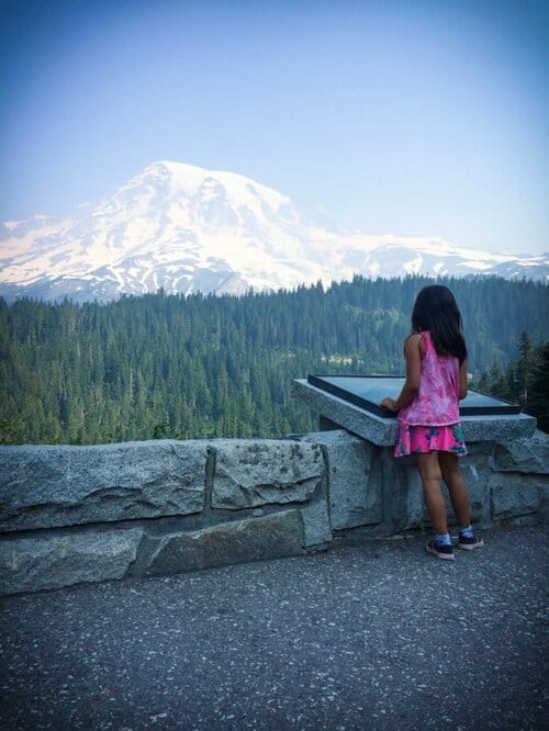A child looking at Mount Rainier summit at Mount Rainier National Park, one of the popular national parks in the west