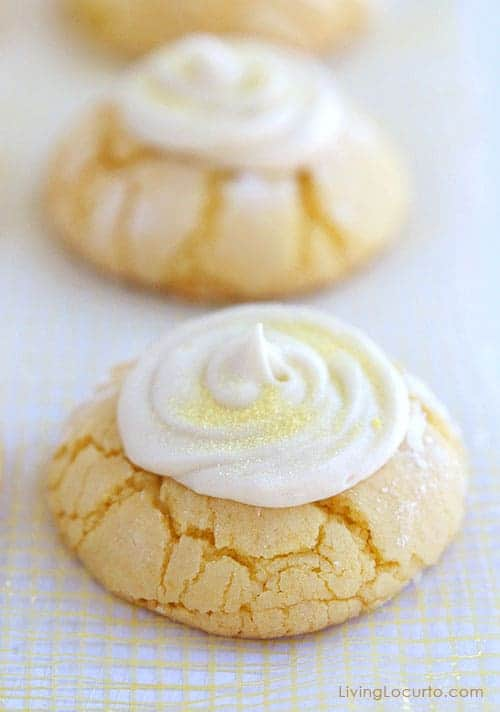 THE BEST Melt in your mouth Lemon Cookies Recipe with homemade Lemon Frosting. Lemon crinkle cake mix cookies.