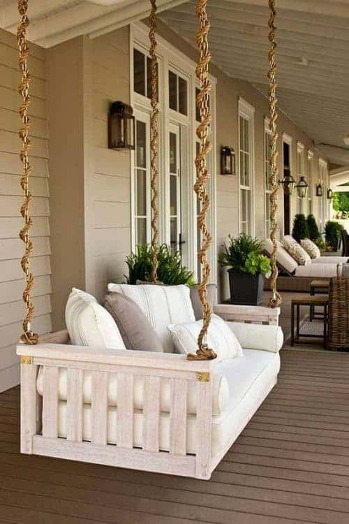Beautiful hanging swinging porch bed. Love the rope design!