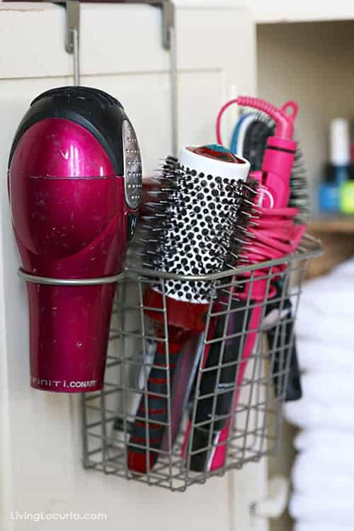 Great Organizing Ideas for your Bathroom! Love this hanging hair dryer and brush storage basket! Cabinet Bathroom Organization Makeover - Before and After photos.