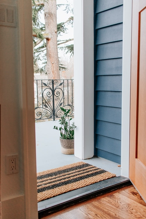 DIY Doormat tutorial - Make an inexpensive and custom striped or monogrammed doormat with just a few materials.  Perfect for all seasons!