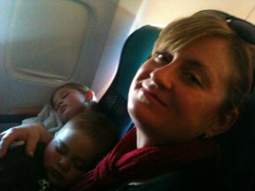 toddler sleep on a plane, toddler sleep on plane, sleep on a plane, flying with toddler, traveling with kids