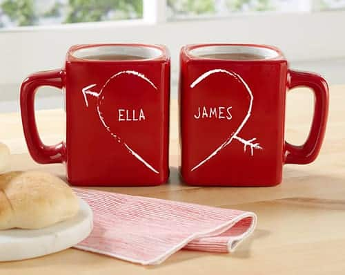 Set of red coffee mugs that make an image of a heart when placed side by side