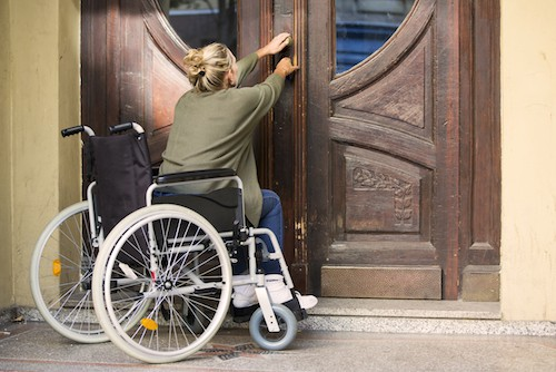 Woman in Wheelchair Opening Non-ADA Complaint Door - Harry's Locksmith