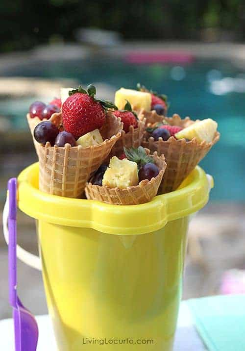 Pool party ideas! Fruit in waffle cones.